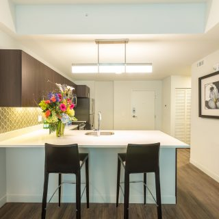 kitchen with wooden cabinets and white counter tops at midtown park apartments