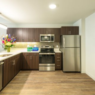 kitchen with stainless steel appliances and flowers in midtown park apartments