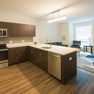kitchen with stainless steel appliances in residences at midtown park apartments