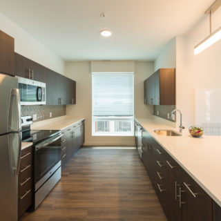Kitchen with wood cabinets in wilmington, de riverfront apartments