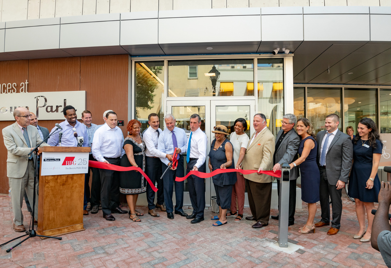Midtown Park management cutting red ribbon