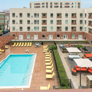 Pool and lounge chairs at the residences at midtown park apartments